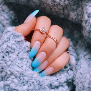 cozy-sweater-and-girls-hand-with-a-beautiful-blue-XGLEZWE-min-1-min-scaled.jpg