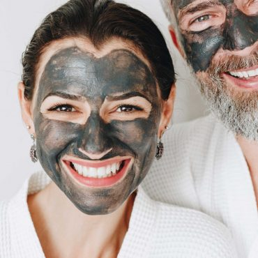 happy-couple-wearing-a-charcoal-mask-AXYBWQ9-scaled-1.jpg